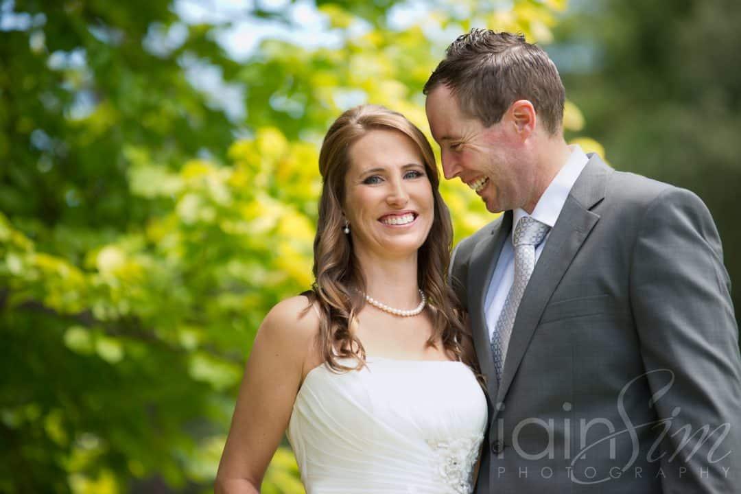 Groom looking at beautiful bride