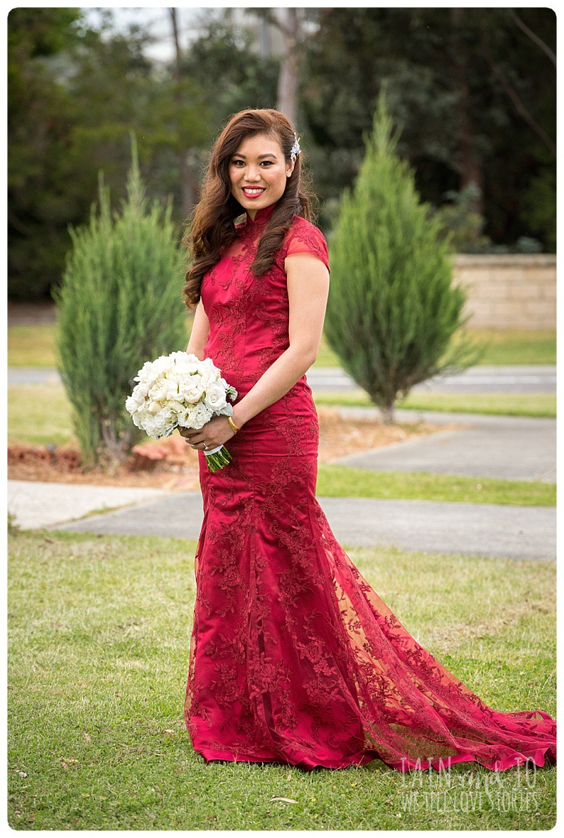 Full-length portrait of the gorgeous bride in the red dress she wore to her tea ceremony