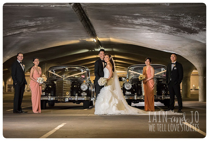 The bridal party with cars provided by TripleR Cars, in the carpark at Melbourne University