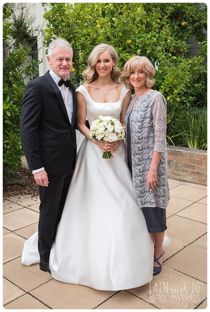 Bride with Her Parents Before The Wedding