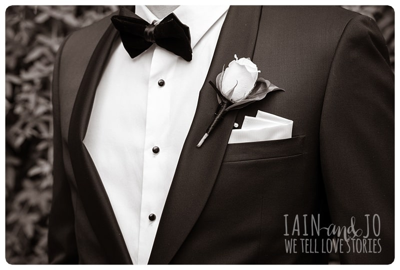 Close-Up Shot of Groom's Coat, Bow and Boutonniere