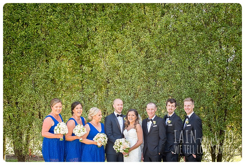 Bridesmaids and groomsmen posing with groom