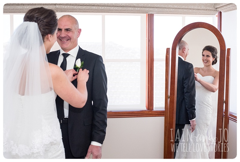 Bride fixes dad's boutonniere