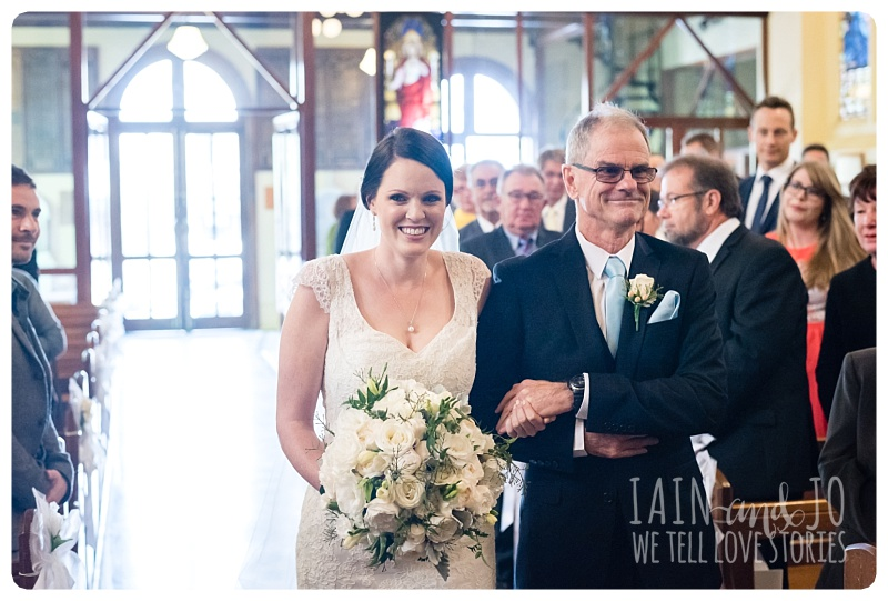 dad and daughter down the aisle