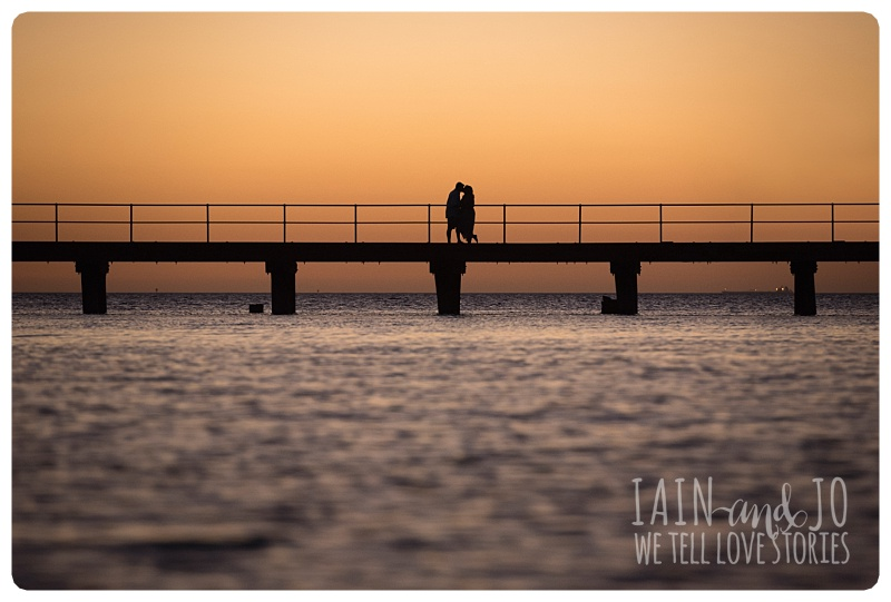 Couple on a bridge during sunset