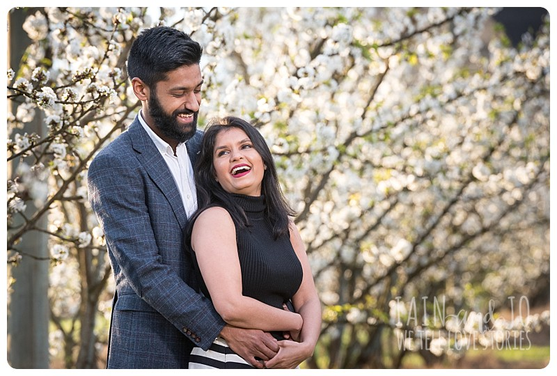 engagement session with cherry blossoms