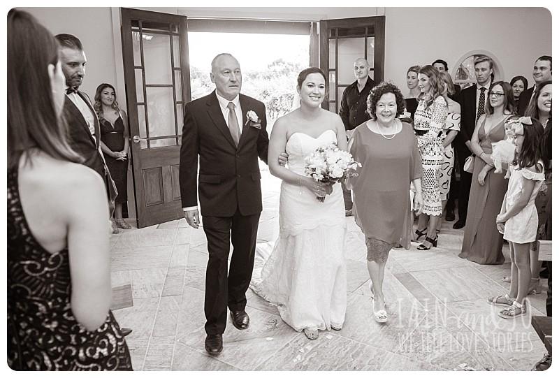 Bride enters chapel with parents